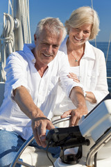 Happy Senior Couple Using SatNav GPS on a Sail Boat