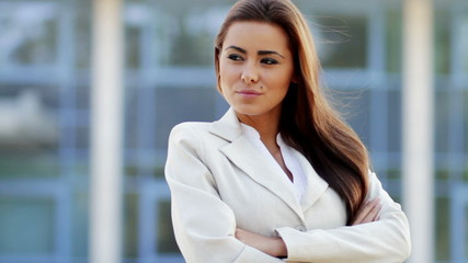 Attractive young business woman outside office building