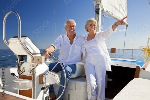 Happy Senior Couple At The Wheel of a Sail Boat - 35503853