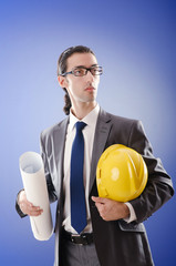 Young architect with drawings and hardhat
