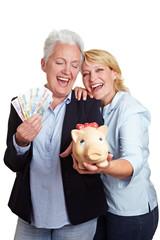 Glückliche Frauen mit Geld