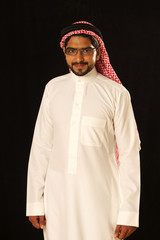 Arab male model standing and smiling.