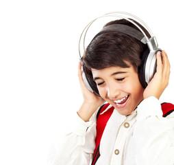 Pretty teen boy enjoying music