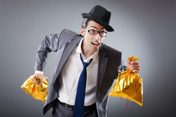 Businessman with sacks of presents