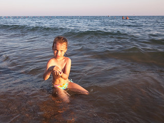 Child in sea water.