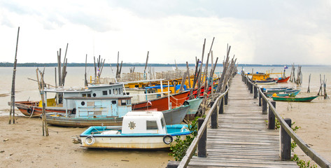 Rugged Fishing Boats and Pier at Low tide in Malaysia