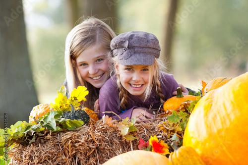 girls having fun outdoor in autumn