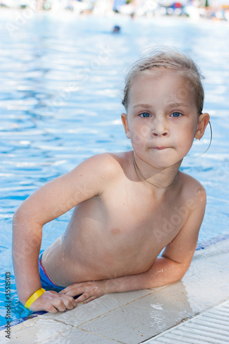 Adorable girl in swimming pool