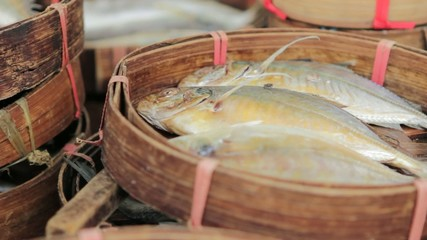 Three fish in a basket at an Asian market