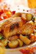 Whole roasted chicken with potatoes and apples