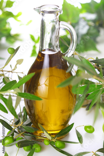 bottle of olive oil with branch olives