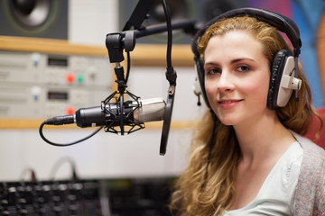 Young woman posing with a microphone