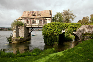 The old mill on medieval bridge in Vernon, Normandy