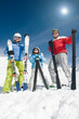 Family ski team on winter holiday (copy space, cover)