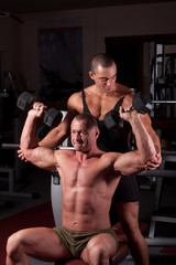 Bodybuilders exercising