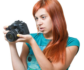 Beautiful young redhead girl looking at her camera