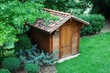 Wooden garden tool shed in a beautiful park