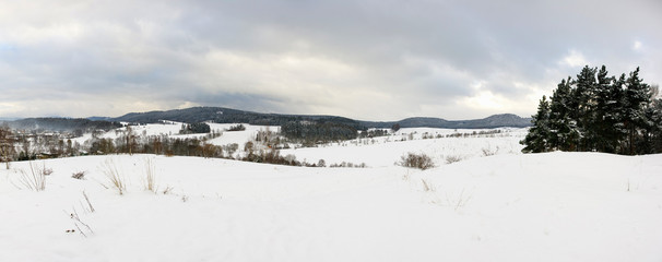 Panoramic winter landscape in the hills
