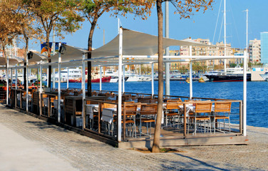 restaurant on a terrace on quay in port of barcelona, spain, cat