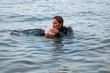 Leinwandbild Motiv Diving rescue
