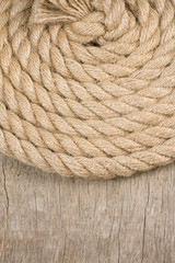 ship ropes and knot on wood texture
