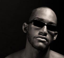 Hip muscular black man in sunglasses
