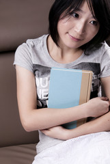 Thinking beautiful girl with the book