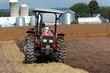 Farmer plowing the soil
