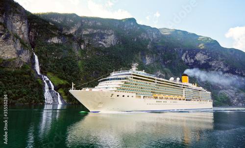 Leinwandbild Motiv Cruise ship in fiord