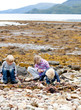 Children exploring a scottish beach
