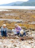 Children exploring a scottish beach
