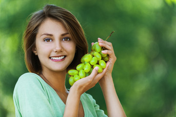 beautiful woman holding grapes