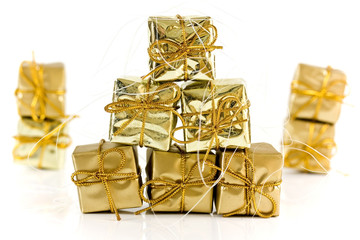 Gold wrapped parcels on a white background