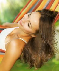 Beautiful Young Woman relaxing in hammock