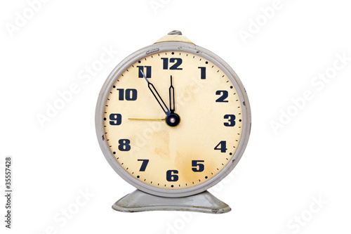 Vintage alarm clock, isolated on white background