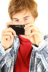 young man taking pictures with his camera
