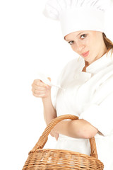 attractive cook woman with wicker basket, white background