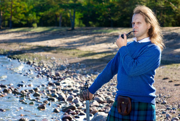 Man in scottish costume with pipe