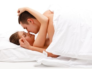 Young couple caressing each other in bed