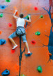 man climbing on a climbing wall