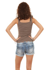 portrait of girl from back in trousers, jeans shorts