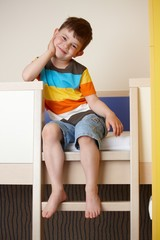 Happy little kid on bunk bed