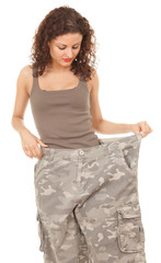 young woman in too great camouflage trousers
