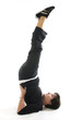 middle age woman demonstrating yoga position half shoulderstand
