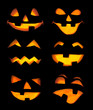 Carved Jack-o-lanterns lit for Halloween