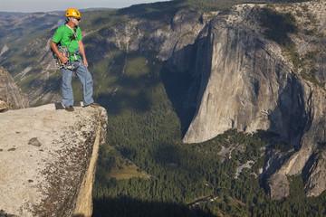 Rock climber celebrates on the summit.