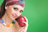 fashion woman with red apple on the green background