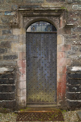 Old castle door with a lot of characteristic features.
