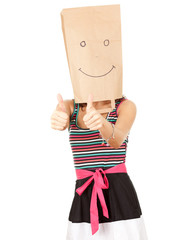 woman in smiling ecological paper bag on head with thumbs up