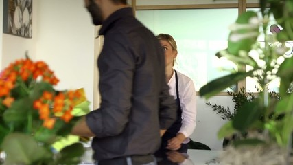 Sales manager at counterand client shopping in flowers shop